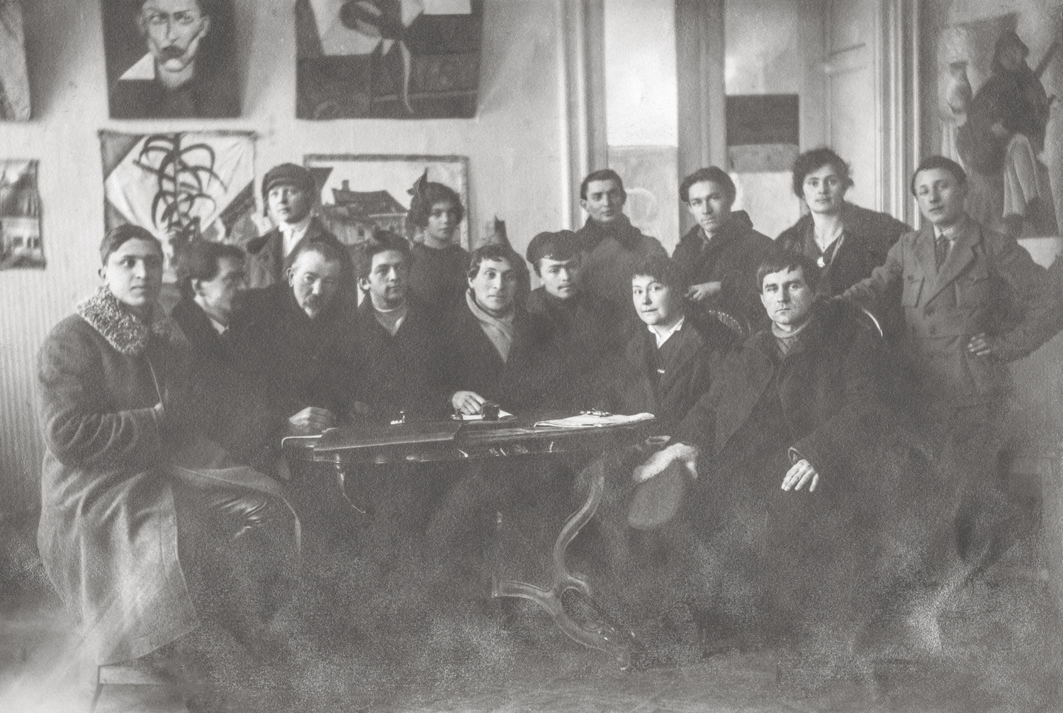 Members of the Creative Committee of the People's Art School, Vitebsk, winter 1919.  Seated: Yuri (Yehuda) Pen (third from left), Marc Chagall (center), Vera Ermolaeva (second from right), Kazimir Malevich (right).  Gelatin silver print. Archives Marc et Ida Chagall, Paris.