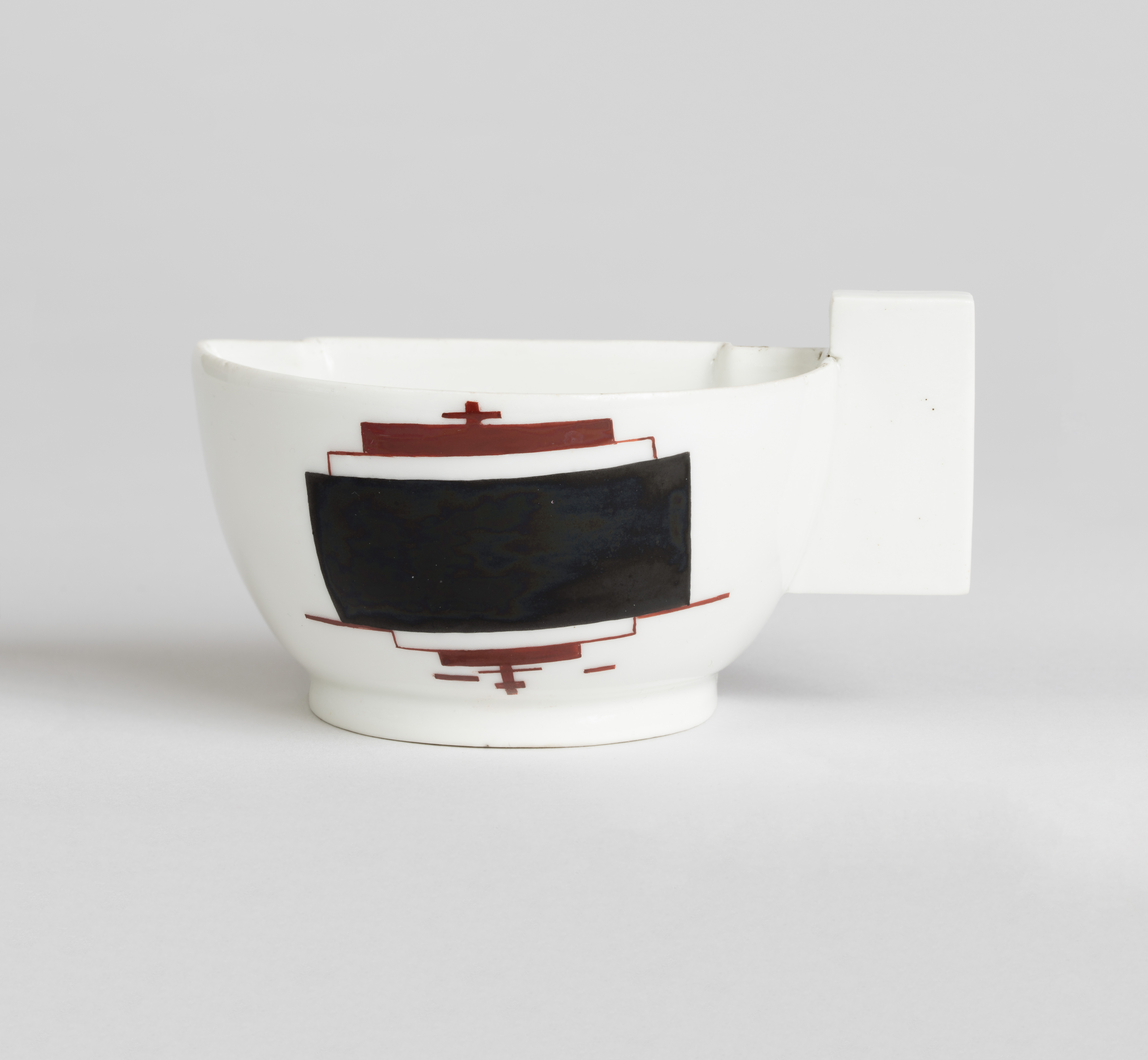 Kazimir Malevich and Ilya Chashnik, Half Teacup, 1923, made by the State Porcelain Manufactory (former Imperial Manufactory), Petrograd, enameled, glazed and molded porcelain. Cooper Hewitt, Smithsonian Design Museum, The Henry and Ludmilla Shapiro Collection; partial gift and partial purchase through the Decorative Arts Association Acquisition and Smithsonian Collections Acquisition Program Funds. Image provided by Cooper Hewitt, Smithsonian Design Museum / Art Resource, NY